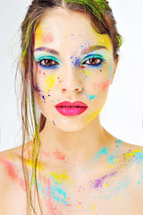 Woman face with spray paint on a white background