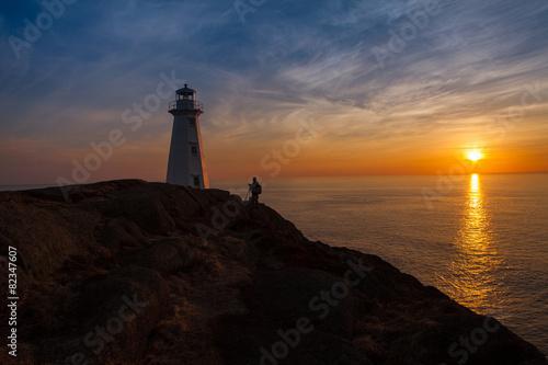 Fotobehang Vuurtoren / Mill Photographer at Lighthouse at Ocean Sunrise