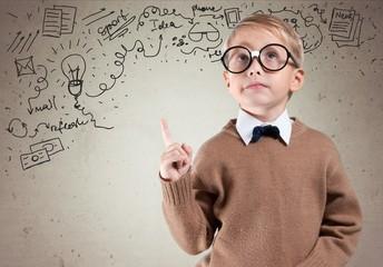 Kid. Portrait of male elementary school student with lightbulb
