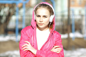Spring portrait of the girl headphones music player concept