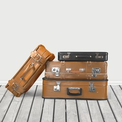 Object. Vintage weathered leather suitcases on top of each other