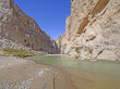 Desert River Entering a Remote Canyon - 82353035