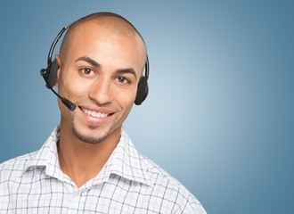 Headset. Attractive Business Man with Phone Headset