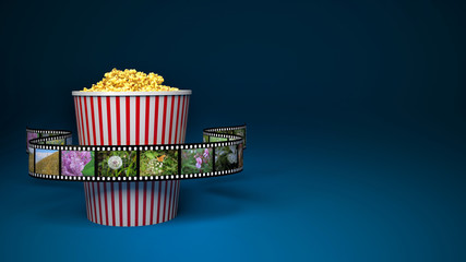 paper bag with popcorn and movie reel