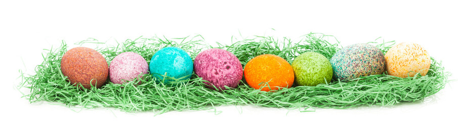 Colorulf easter eggs nest isolated on white background