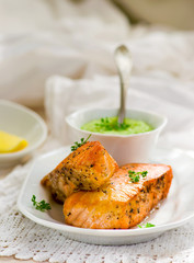fried fillet of a salmon with green peas sauce