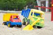 Leinwanddruck Bild - Sandspielzeug in einem Sandkasten