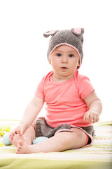 Surprised baby girl with bunny hat