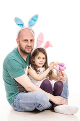 Cheerful father and daughter with bunny ears