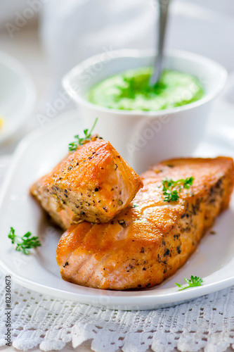 fried fillet of a salmon with green peas sauce - 82360673