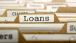 Loans Concept with Word on Folder. - 82361478