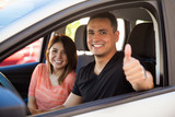 Man and wife driving their car
