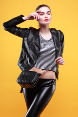 beautiful girl is in fashion style on yellow background, glamour