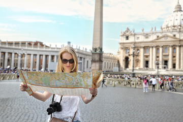 A tourist visits the Vatican and St. Peter's Square