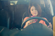 Texting behind the wheel - 82365658