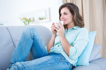 Peaceful woman drinking cup of coffee
