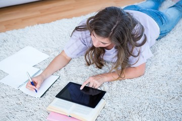 Pretty woman with books and tablet pc