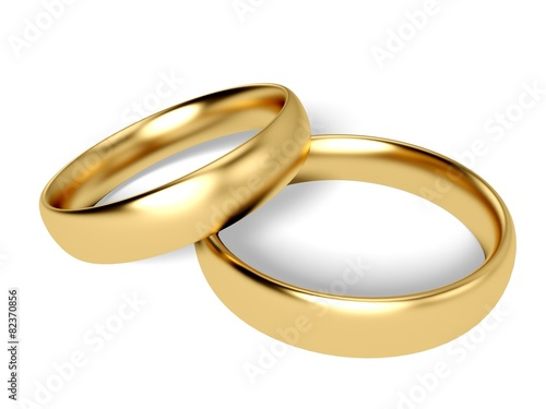 Zdjęcia na płótnie, fototapety, obrazy : Wedding. 3D. Two gold wedding rings - reflected candles