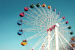 Giant ferris wheel against blue sky, Vintage