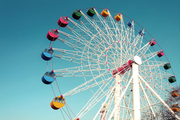 Giant ferris wheel against blue sky, Vintage