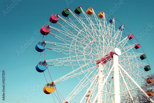 Leinwandbild Motiv Giant ferris wheel against blue sky, Vintage