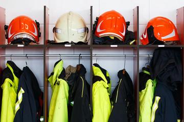 Fireman's helmet and jackets in the locker