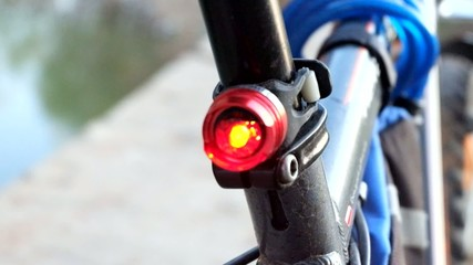 Rear part of the velo bike with flashing red light