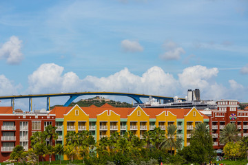 Cruise Ship and Bridge Beyond Colorful Resort