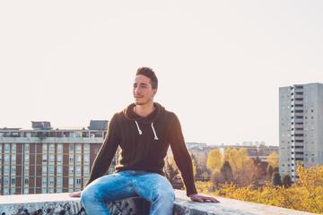Young  man posing in an urban context