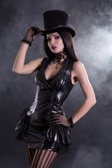Cabaret girl in fetish dress and tophat