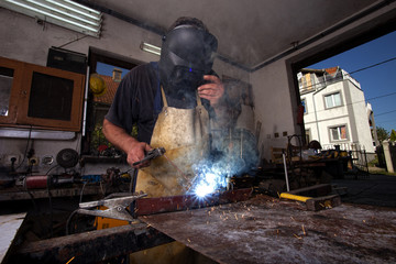 Man welding in workshop,shallow depth of filed