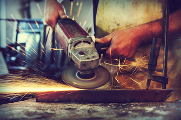 Man Grinding in workshop,shallow depth of filed