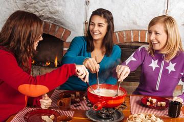 Friends having fondue dinner