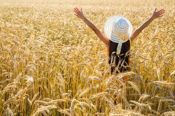 Girl on wheat field