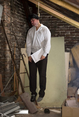 man is hanged in the attic