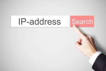 businessman finger pressing search button ip address