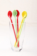 colorful spoon in clear glass