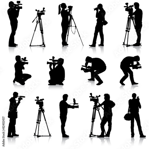 Cameraman with video camera. Silhouettes on white background. Ve - 82402457