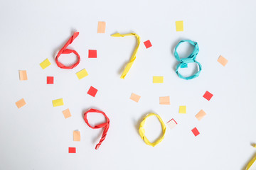 Colourful paper number on white background (6 7 8 9 0)