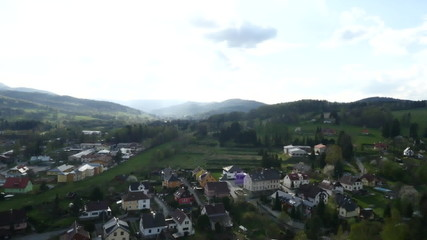 Aerial View. Panorama. Flight over a green grassy in mountains.