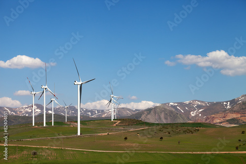 canvas print picture Wind farm at sun spring day