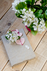 A bouquet of white spring flowers and old vintage notebook
