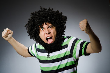 Funny man with afro hairstyle isolated on white