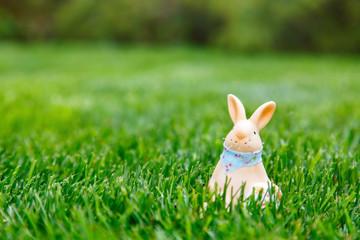 Ceramic rabbit with green grass background