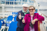 Senior Couple With Thumbs Up on Deck of Cruise Ship