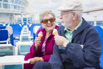Senior Couple Enjoying Ice Cream On Deck Of Cruise Ship