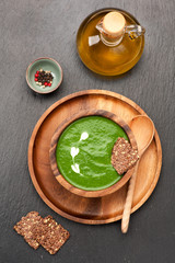 Spinach soup in a wooden bowl. top view.