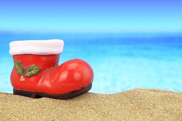 Santa claus boot ornament on sandy beach
