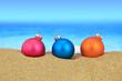 Christmas balls on sandy beach