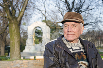 The senior sitting on the bench in park of Vienna